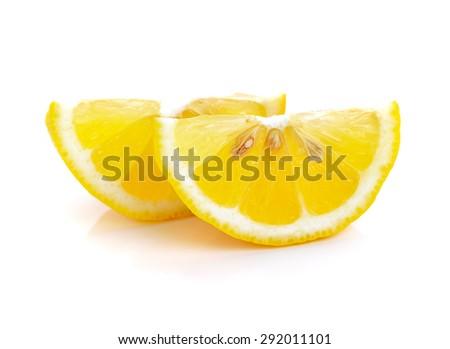 Slice of lemon fruit isolated on white background - stock photo