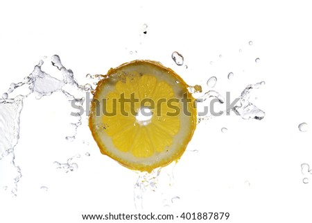 slice of lemon in  water with bubbles - stock photo