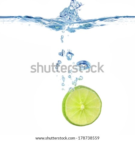 slice of lime in the water - stock photo