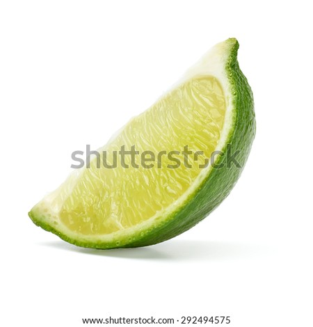 Slice of lime wedge isolated on white background with clipping path - stock photo