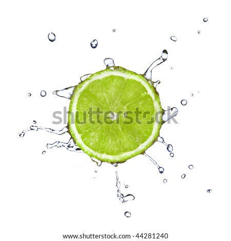 Slice of lime with water drops isolated on white - stock photo