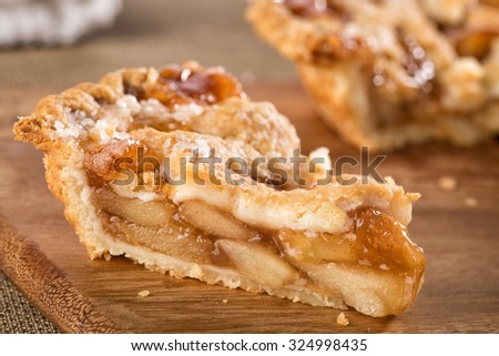 Slice of mouth watering rustic apple pie - stock photo