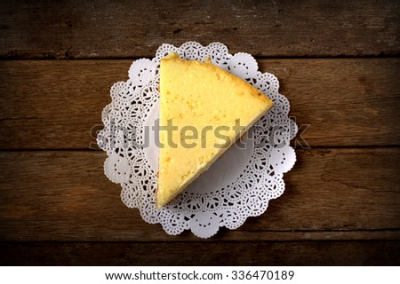 Slice of new york cheesecake on wooden table - stock photo