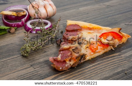 slice of pizza on a wooden table