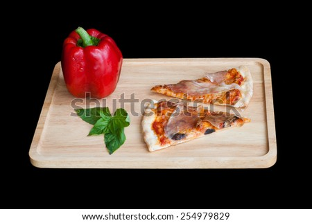 Slice of pizza on wooden Tray - stock photo