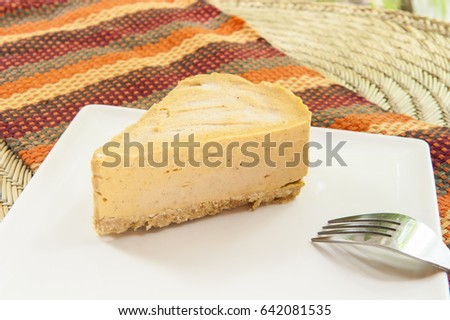 Slice of pumpkin pie ice cream cake on a white plate