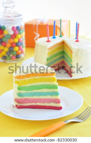 Slice of rainbow cake - stock photo