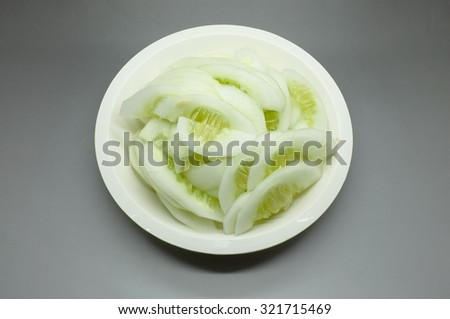 Slice of raw fresh cucumber - stock photo