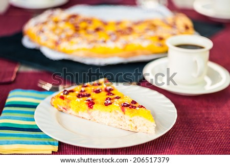 Slice of red currant and quark cake with a cup of coffee - stock photo
