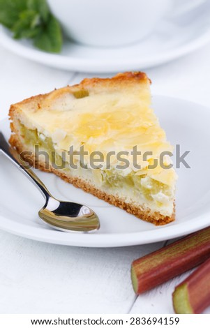 Slice of rhubarb pie on wooden table.