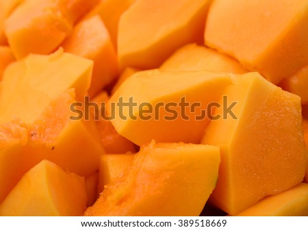 Slice of ripe orange papaya or pawpaw a popular tropical fruit with a sweet flesh - stock photo