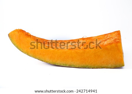 Slice of ripe orange pumpkin on a white background  - stock photo
