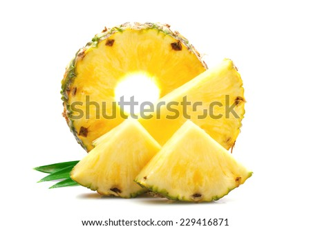 Slice of ripe pineapple with leaves. - stock photo