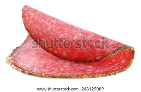 Slice of salami isolated on white background - stock photo