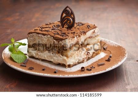 Slice of self-made italian tiramisu dessert served on a plate - stock photo