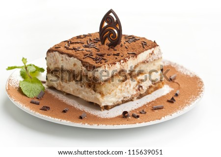 Slice of self-made italian tiramisu dessert served on a plate - stock photo