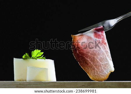 slice of smoked ham on a fork - stock photo
