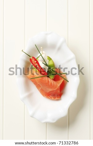 Slice of smoked salmon, baby mozzarella and kiwi