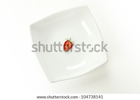 slice of strawberry on the white plate - stock photo