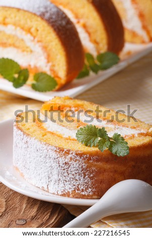 Slice of sweet carrot rolls on a plate and juice closeup. vertical