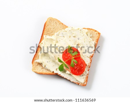 Slice of white bread with cheese spread