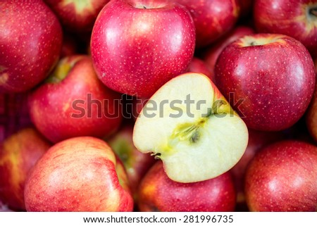 slice piece of apple with group of red apples - stock photo