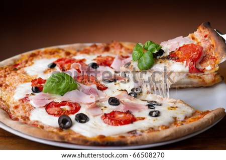 slice pizza  with buffalo mozzarella and ham - stock photo