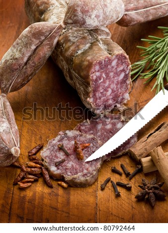 slice salami, susage and spice over cutting board - stock photo