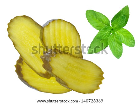slice salt pickle with mint isolated on white - stock photo