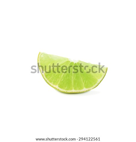 Slice section of green lime isolated over the white background