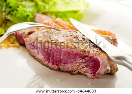 slice t-bone with salt - stock photo