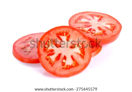 Slice tomato isolated on the white background. - stock photo