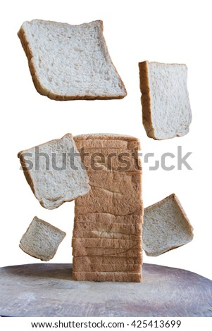 slice whole wheat bread isolated on chopping board and white background - stock photo