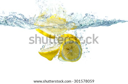 slice yellow lemon in water, motion action. - stock photo