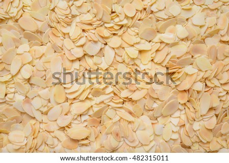 Sliced almonds background. Top view