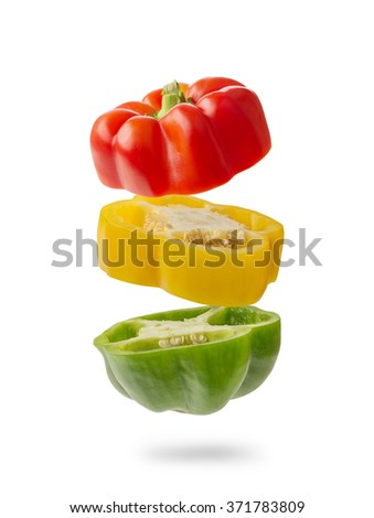 sliced and falling multicolored peppers isolated on white background - stock photo