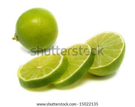 Sliced and whole fresh lime isolated on white background - stock photo