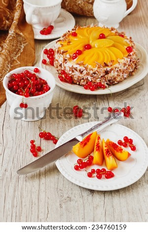 sliced apricots, red currant and fruit cake on the holiday table. festivals and events.