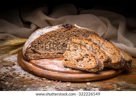 Sliced artisan bread on cutting board - stock photo