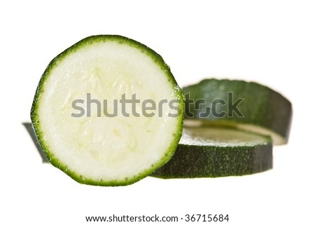 Sliced baby marrow on a white backround - stock photo