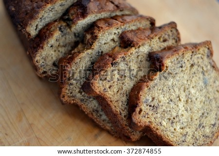 Sliced Banana Bread on Wooden Board, closeup