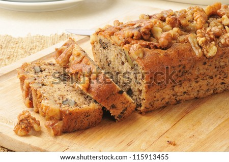 Sliced banana bread with walnuts - stock photo