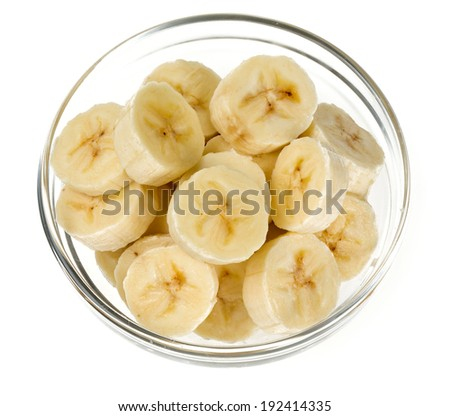sliced banana in a glass bowl isolated on white - stock photo