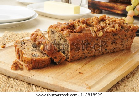 Sliced banana nut bread on a cutting board - stock photo
