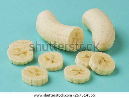 Sliced banana on a blue background. - stock photo