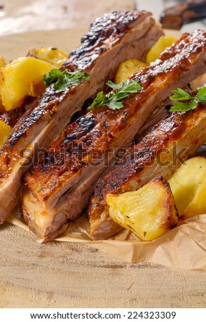 Sliced beef ribs and baked potatoes,selective focus  - stock photo