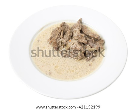 Sliced beef with white sauce. Isolated on a white background.