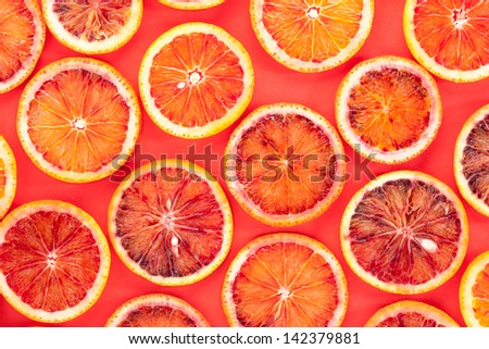 Sliced blood oranges pattern photography