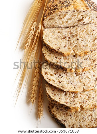 Sliced bread and ears isolated on white - stock photo