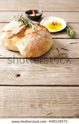 Sliced bread Ciabatta and rosemary on wooden background
